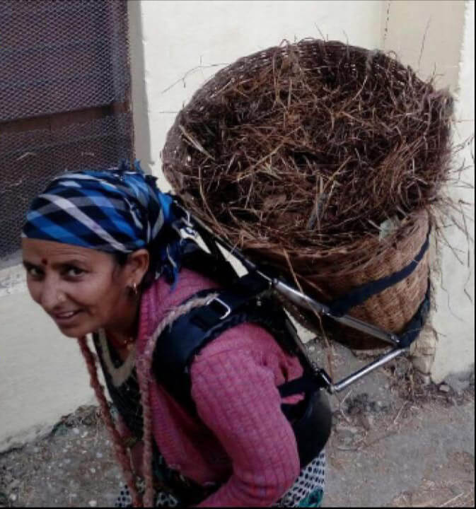 Woman using load carrying device
