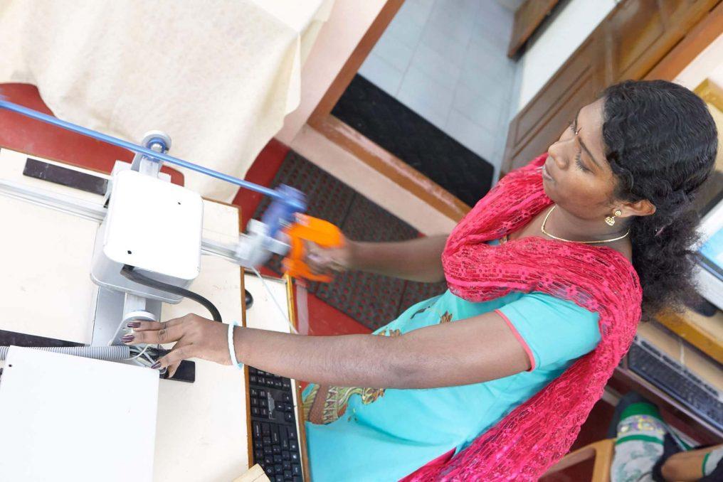A women using the APTAH haptics simulator