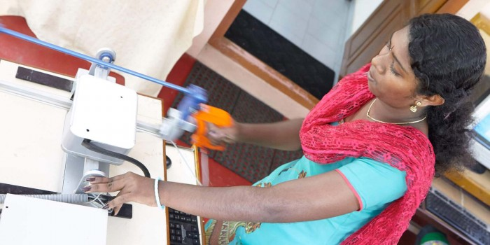 A women using the APTAH haptics simulator