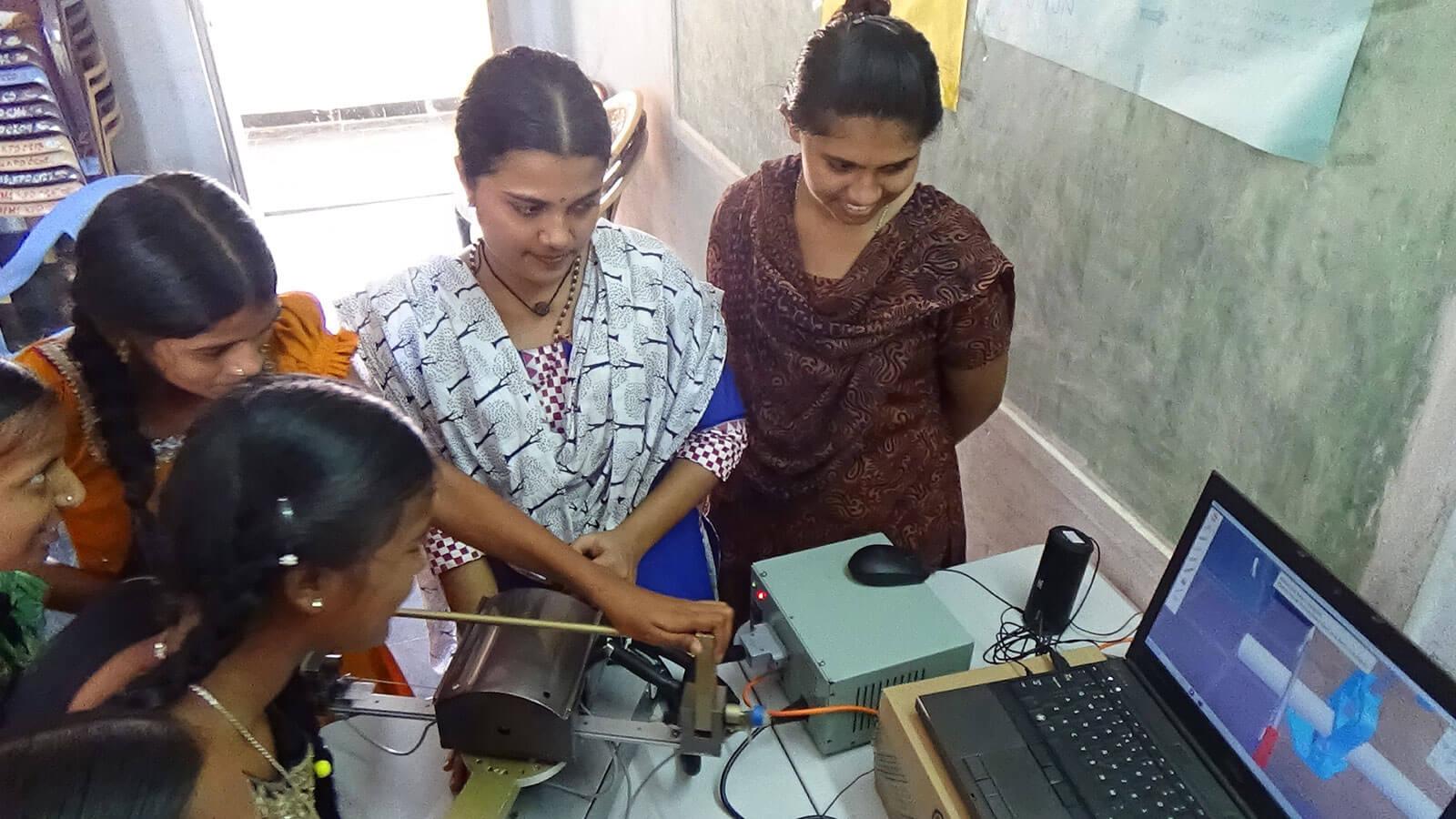 Women using the haptics simulator