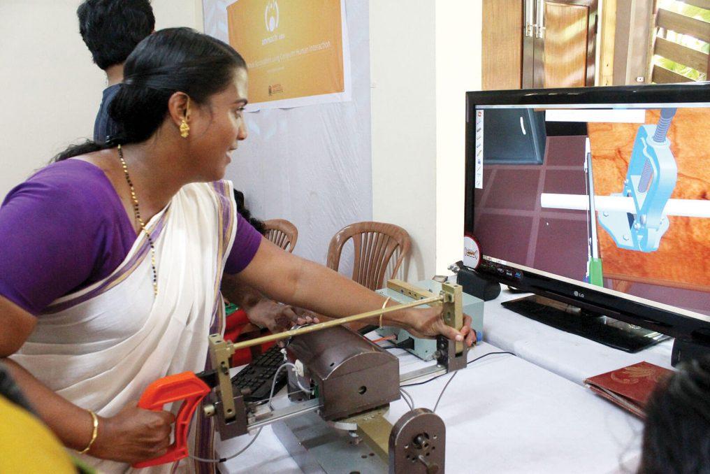 Woman using haptics simulator