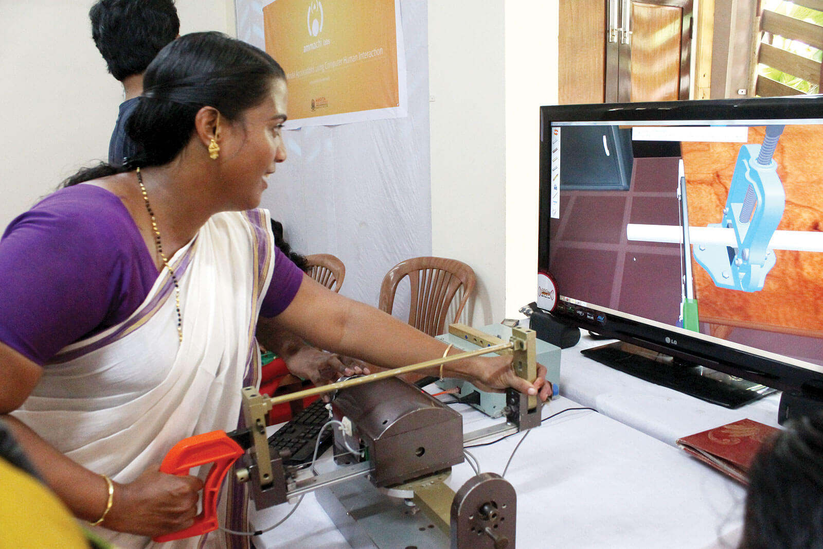 Woman using haptics simulator